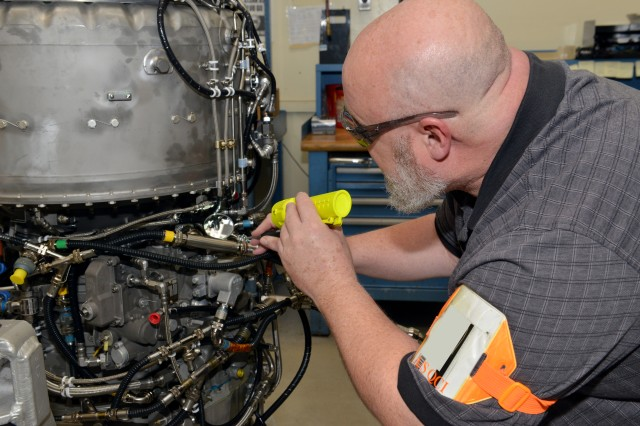 Quality control inspector Paul Schwab gives Corpus Christi Army Depot's 1,000th T55 engine a final inspection before sending it on its way, Jan. 5, 2018. The T55 engine must meet the highest industrial standards before it's paired up to power the US Army's mammoth CH-47 Chinook.