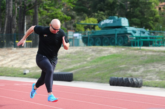 PRESIDIO OF MONTEREY, California -- Sgt. Nick Cunningham, Army World Class Athlete Program, gets sprinting work in at the Physical Fitness Facility track here Jan. 2 while home on leave for the holidays. He will drive two-man and four-man USA bobsleds in his third Winter Olympics Games in Korea, Feb. 9-25.