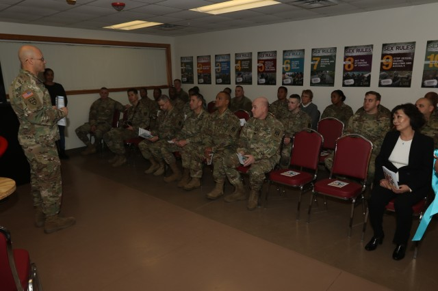 Sgt. 1st Class Lee T. Watson, 35th Air Defense Artillery Brigade sexual assault response coordinator, presents a speech to Soldiers and civilians from 35th ADA BDE at the grand opening of Sexual Harassment & Awareness Response Program (SHARP) 360 training facility Jan. 17, 2018, at Osan Air Base, South Korea. The 35th ADA BDE SHARP 360 training facility provides vignette-based training with real-life back drop scenarios where Soldiers and civilians learn behavior associated with sexual harassment and sexual assault as well as gain and practice the skills to confidently intervene.