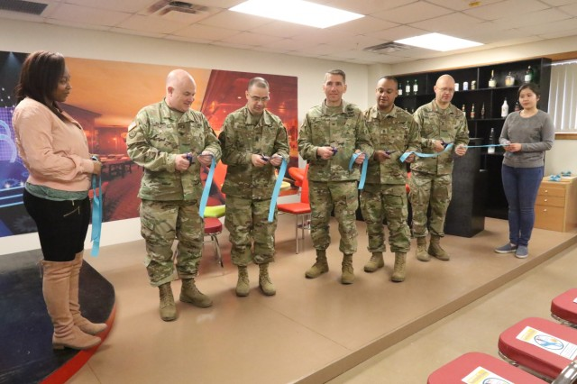 35th Air Defense Artillery Brigade senior leaders and 35th ADA BDE sexual assault response coordinator cut a ribbon noting the grand opening of the Sexual Harassment & Awareness Response Program (SHARP) 360 training facility Jan. 17, 2018, at Osan Air Base, South Korea. The 35th ADA BDE SHARP 360 training facility provides vignette-based training with real-life back drop scenarios where Soldiers and civilians learn behavior associated with sexual harassment and sexual assault as well as gain and practice the skills to confidently intervene.