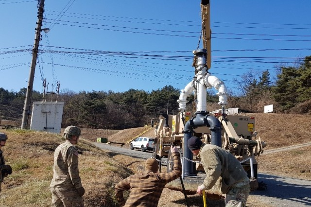 "The 2nd Infantry Division Sustainment Brigade Soldiers extract ""Pipeman Pete"" and prepare monument for onward movement to Camp Humphreys."