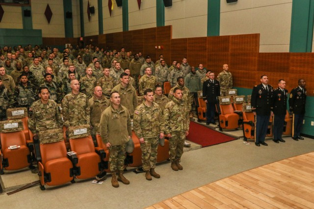 Soldiers with 210th Field Artillery Brigade and special guest Brigadier Gen. Jon Howerton, deputy commanding general-maneuver of the 2nd Infantry Division/ROK-US Combined Division, stand at attention to sing the Warriors March during the Martin Luther King Jr. Observance at Casey Theater, Camp Casey, Republic of Korea, Jan. 11, 2018. The observance was to honor the life and achievements of Dr. King Jr., who became the most visible spokesperson and leader in the civil rights movement from 1954 through 1968. (U.S. Army photo by Sgt. Michelle U. Blesam, 210th FA BDE PAO)