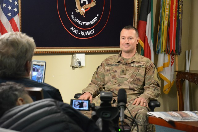 "171208-A-RW053-001 Staff Sgt. Casey McMurray, 371st Sustainment Brigade, interviews for the film documentary, ""The World's Most Dangerous Paper Route"", at Camp Arifjan, Kuwait December 8, 2017. (U.S. Army photo by Sgt. 1st Class Charles Highland)"