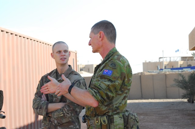 U. S. Army Capt. Jonathan Campbell (left), the 449th Combat Aviation Brigade physician assistant, discusses medical procedures with Australian army Maj. Greg Button, the senior medical officer at the Role Two Enhanced Medical Facility during a mass casualty training exercise at Camp Taji, Iraq, Jan. 18, 2018. This training is part of the overall Combined Joint Task Force -- Operation Inherent Resolve building partner capacity mission which focuses on training and improving the capability of partnered forces fighting ISIS.  (U.S. Army Photo by Staff Sgt. Leticia Samuels)