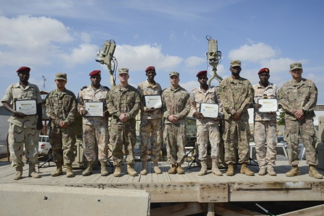 Soldiers assigned to Combined Joint Task Force-Horn of Africa's communications directorate and Djiboutian service members pose for a photo after completing a military-to-military exchange course at Camp Lemonnier, Djibouti, Jan. 17, 2018. Throughout a two-week period, communications experts advised Djiboutian service members on how to setup, operate, maintain and troubleshoot network equipment to increase communication capabilities.