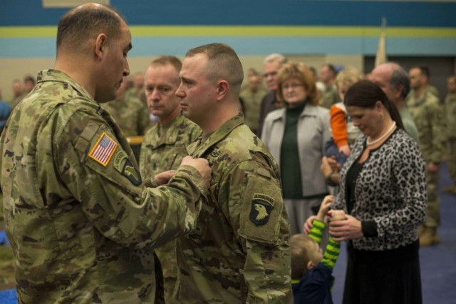 Maj. Gen. Andrew Poppas, 101st Airborne Division (Air Assault) commanding general, pins the Soldier's Medal on Staff Sgt. Nicholas Davis, C Battery, 1st Battalion, 320th Field Artillery Regiment, 101st Airborne Division (Air Assault) artillery cannon crew member and section chief, during a ceremony held at Fort Campbell, Jan. 22, 2018. Davis, an Ellijay, Georgia, native and seven-year combat veteran with deployments to Iraq and Afghanistan, received the award for heroism and his lifesaving actions when he rescued a couple from a burning vehicle, June 9, 2017.