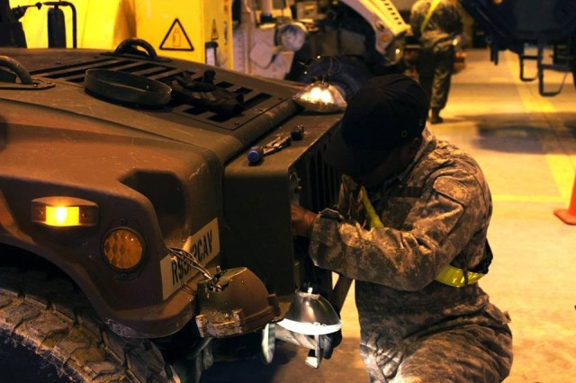 A mechanic assigned to Bravo Troop, Regimental Support Squadron, 2d Cavalry Regiment conducts maintenance on a Humvee during a maintenance shock exercise from Jan. 8, 2018 on Rose Barracks, Germany. The objective of the maintenance shock was for the squadron leaders to conduct a surprise exercise to evaluate the readiness of various military vehicles, communication equipment, mounted weapon systems and mobile ground support equipment.