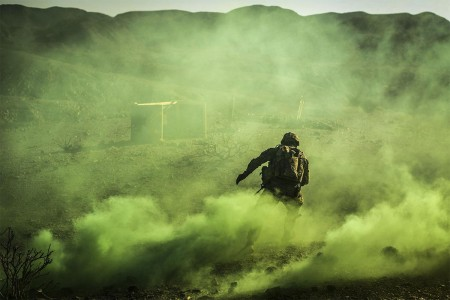 A Soldier from 10th Mountain Division, assigned to Combined Joint Task Force-Horn of Africa's East African Response Force, maneuvers through a smoke screen during live fire exercise in Djibouti, Africa, Dec. 27, 2017. The purpose of the EARF is to rapidly provide tailorable packages of forces to protect American interests on the continent of Africa should any threats arise.