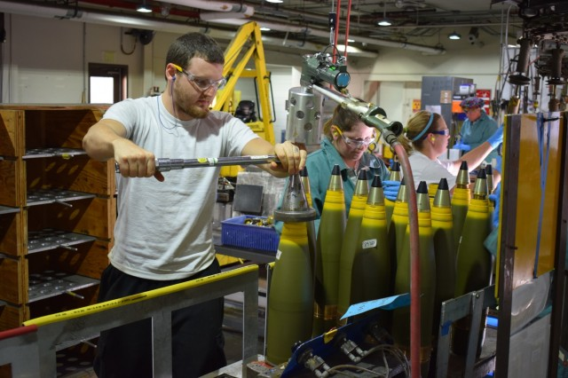 "A Crane Army Ammunition Activity explosives operator torques the fuse to a 5""/54 projectile body during recent production.  Crane Army met a critical production deadline in 2016 for its customer, the U.S. Navy."