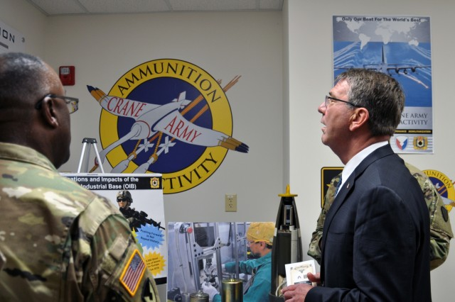 Brig. Gen Richard Dix, commanding general of Joint Munitions Command, briefs Secretary of Defense Ashton Carter on Crane Army Ammunition Activity's mission to provide logistical support to meet conventional munitions requirements in support of Joint Force readiness. It is one of 14 installations of Joint Munitions Command and one of 23 organic industrial bases under U.S. Army Materiel Command, which include arsenals, depots, activities and ammunition plants.