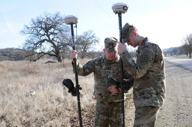 Army Reserve engineers conducting troop projects get real-world training and experience while helping the garrison improve infrastructure and reduce costs. Specialists Shannon Ogerly and Richard Loveday with the 926th Engineer Brigade calibrating GPS equipment to survey area at Fort Hunter Liggett, Calif., January 12, 2018.