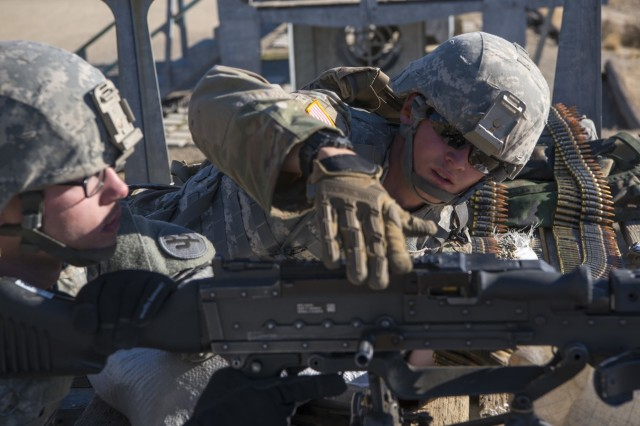 U.S. Army Reserve Pfc. Ryan Koranda, 56th Military Police Company loads ammunition into an M240B machine gun, assisting Spc. Cody Basham, 182nd Transportation Company during Operation Cold Steel II at Fort Hunter Liggett, Calif., Dec. 5, 2017. Approximately 100 military police Soldiers with the 200th Military Police Command participated in Operation Cold Steel, the largest gunnery operation in the history of America's Army Reserve led by the U.S. Army Reserve and hosted by the 79th Theater Sustainment Command, training Soldiers to work as gunnery teams with crew-served weapons. (U.S. Army Reserve photo by Capt. Valerie Palacios/200th Military Police Command)