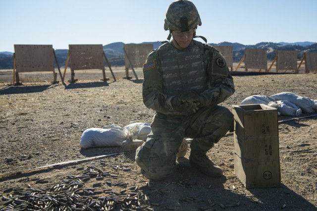 U.S. Army Reserve Pfc. Konner Krouse, 56th Military Police Company, based out of Mesa, Ariz., collects 7.62 mm brass after qualifying with an M240B machine gun during Operation Cold Steel II at Fort Hunter Liggett, Calif., Dec. 5, 2017. Approximately 100 military police Soldiers with the 200th Military Police Command participated in Operation Cold Steel, the largest gunnery operation in the history of America's Army Reserve led by the U.S. Army Reserve and hosted by the 79th Theater Sustainment Command, training Soldiers to work as gunnery teams with crew-served weapons. (U.S. Army Reserve photo by Capt. Valerie Palacios/200th Military Police Command)