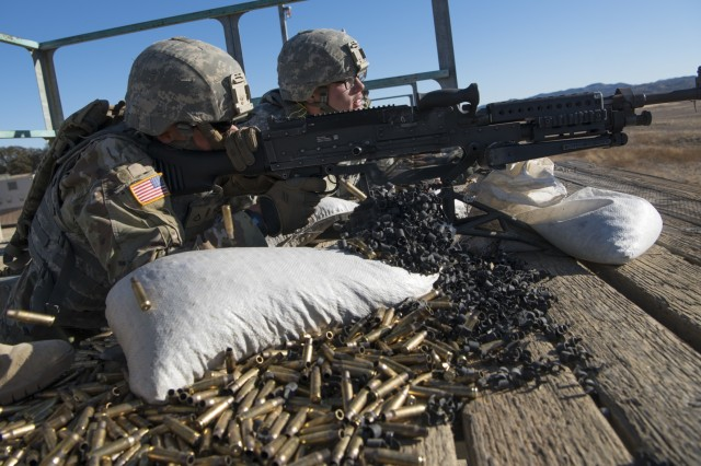 U.S. Army Reserve Spc. Cody Basham, 182nd Transportation Company serves as assistant gunner while Pfc. Ryan Koranda, 56th Military Police Company qualifies with an M240B machine gun during Operation Cold Steel II at Fort Hunter Liggett, Calif., Dec. 5, 2017. Approximately 100 military police Soldiers with the 200th Military Police Command participated in Operation Cold Steel, the largest gunnery operation in the history of America's Army Reserve led by the U.S. Army Reserve and hosted by the 79th Theater Sustainment Command, training Soldiers to work as gunnery teams with crew-served weapons. (U.S. Army Reserve photo by Capt. Valerie Palacios/200th Military Police Command)