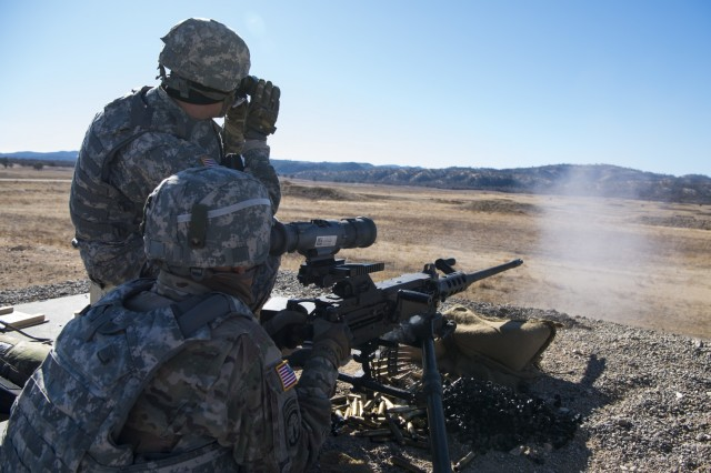 U.S. Army Reserve Spc. Sebastian Austin and Sgt. Jorge Monge, 224th Military Police Company work as a team qualifying with an M2 machine gun during Operation Cold Steel II at Fort Hunter Liggett, Calif., Dec. 5, 2017. Approximately 100 military police Soldiers with the 200th Military Police Command participated in Operation Cold Steel, the largest gunnery operation in the history of America's Army Reserve led by the U.S. Army Reserve and hosted by the 79th Theater Sustainment Command, training Soldiers to work as gunnery teams with crew-served weapons. (U.S. Army Reserve photo by Capt. Valerie Palacios/200th Military Police Command)