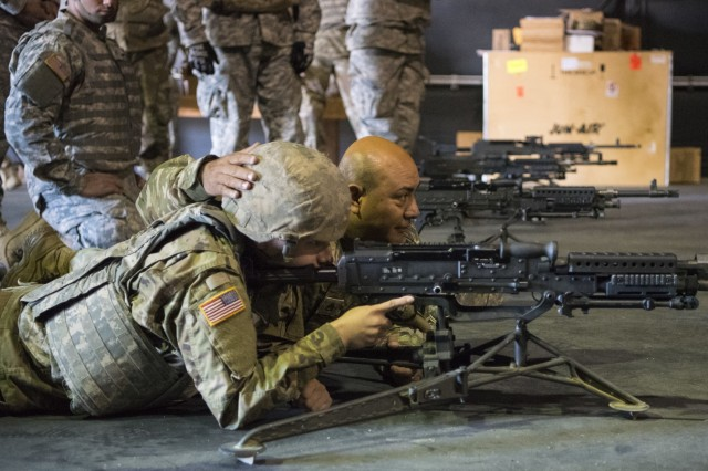 U.S. Army Reserve Staff Sgt. Jesus Valles, 883rd Quartermaster Company, based in Broken Arrow, Okla., provides training on an M240B machine gun during Operation Cold Steel II at Fort Hunter Liggett, Calif., Dec. 4, 2017. Approximately 100 military police Soldiers with the 200th Military Police Command participated in Operation Cold Steel, the largest gunnery operation in the history of America's Army Reserve led by the U.S. Army Reserve and hosted by the 79th Theater Sustainment Command, training Soldiers to work as gunnery teams with crew-served weapons. (U.S. Army Reserve photo by Capt. Valerie Palacios/200th Military Police Command)