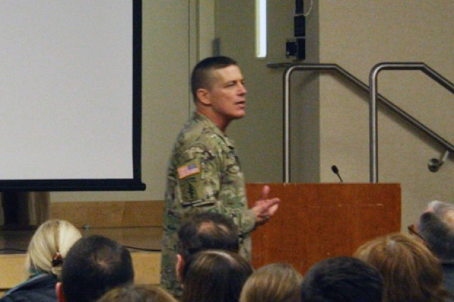 Lt. Gen. Paul Ostrowski addresses a packed audience on changes in the acquisition process.