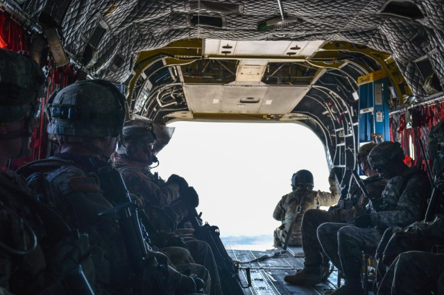 U.S. Soldiers with Easy Troop, 1st Squadron, 11th Armored Cavalry Regiment wait aboard a CH-47 Chinook helicopter from 7th Squadron, 17th Cavalry Regimental during a National Training Center 17-04 air assault training exercise at Fort Irwin, Calif., Feb. 28, 2017. (U.S. Army photo by Pvt. Austin Anyzeski, 11th ACR)