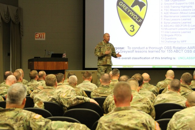 CAMP SHELBY, Miss.- 3rd Armored Brigade Combat Team, 1st Cavalry Division commander, Col. John Woodward, addresses Soldiers of the 155th Armored Brigade Combat Team, Mississippi National Guard during a briefing here Jan. 16. The brief was an opportunity for 3ABCT commanders and staff to share lessons learned from their most recent deployment to Kuwait in support of Operation Spartan Shield with their Army Total Force partners. (Photo by Capt. Scott Kuhn)