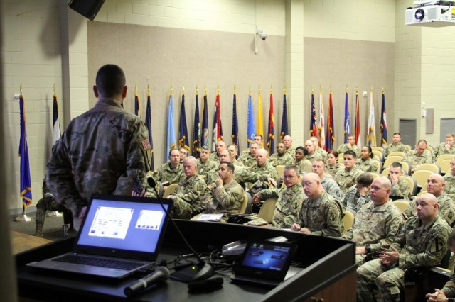 CAMP SHELBY, Miss.-155th Armored Brigade Combat Team, Mississippi National Guard receive a lessons learned brief from a member of the 3rd Armored Brigade Combat Team, 1st Cavalry Division here Jan. 16. The brief was an opportunity for 3ABCT commanders and staff to share lessons learned from their most recent deployment to Kuwait in support of Operation Spartan Shield with their Army Total Force partners.