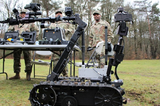 Spc. Jonathan Boyden, right, of the 773rd Civil Support Team demonstrate the Talon IV survey robot during CBRN training at Breitenwald Training Area near Landstuhl, Germany. The active-duty 39th Transportation Battalion trained on Chemical, Biological, Nuclear and Radiological hazards with the Army Reserve's 773rd Civil Support Team.