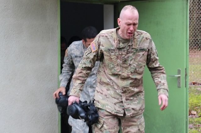 Staff Sgt. Charles Falter, of the 39th Transportation Battalion, tears up after leaving the gas chamber during CBRN training at Breitenwald Training Area near Landstuhl, Germany. The active-duty 39th Transportation Battalion trained on Chemical, Biological, Nuclear and Radiological hazards with the Army Reserve's 773rd Civil Support Team.