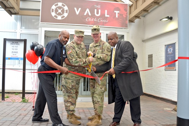 Gregory Neal (from left), Col. Todd Fish, Command Sgt. Maj. Chad Pinkston and Albert White cut the ceremonial ribbon to officially open the Wiesbaden Vault Club and Casino and Bamboo Asian Restaurant on Jan. 23, 2018.