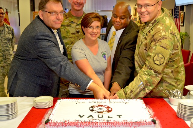Col. Todd Fish (right), U.S. Army Garrison Wiesbaden commander, is joined by MWR managers and community representatives in cutting the cake to mark the opening of the Vault Club and Casino and Bamboo Asian Restaurant.