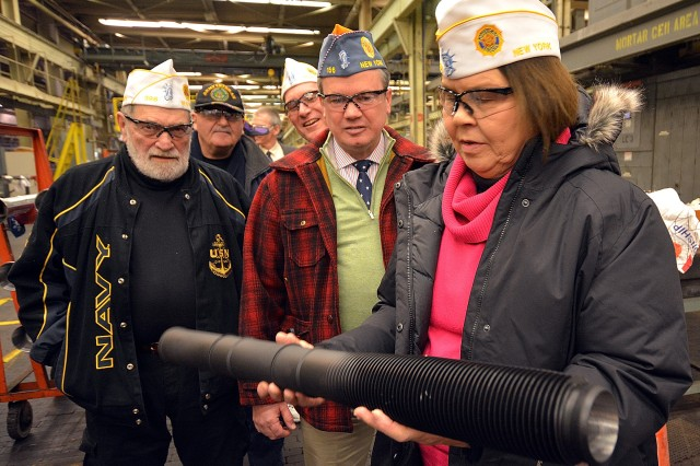 NY State American Legion Department Commander Rena Nessler checking out the weight of a 60mm mortar barrel.