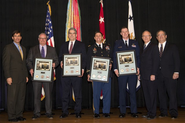"""Winners of the 2017 Major General Harold """"Harry"""" Greene Writing Awards stand with Dr. Mark T. Esper, secretary of the Army (far left), Hon. Bruce D. Jette, assistant secretary of the Army for acquisition, logistics and technology (ASA(ALT)) (second from right) and Mr. Jeffrey S. White, principal deputy to the ASA(ALT)."""