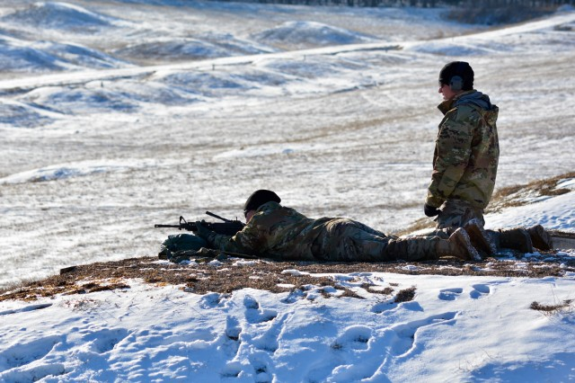 Staff Sgts. Jessica Chavez, left, and Steven Lorance, right, practice the new marksmanship techniques they learned during a leader's certification course held by 1st Battalion, 48th Infantry Regiment, Jan. 15 through 19.