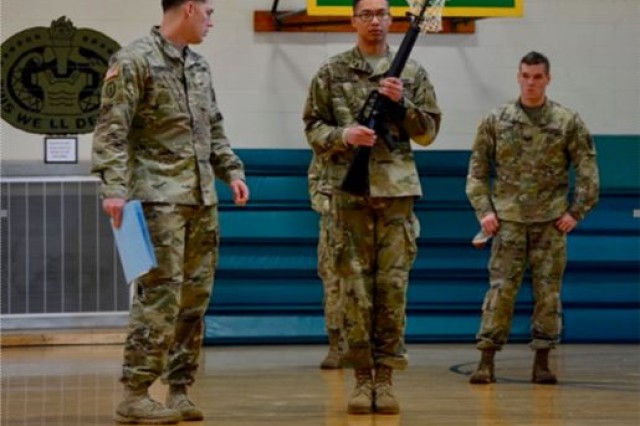 Sgt. 1st Class Allen Addison, Old Guard platoon sergeant, left, points out proper form while Sgt. Jacob Rundquist, Old Guard, center, demonstrates drill and ceremony techniques.