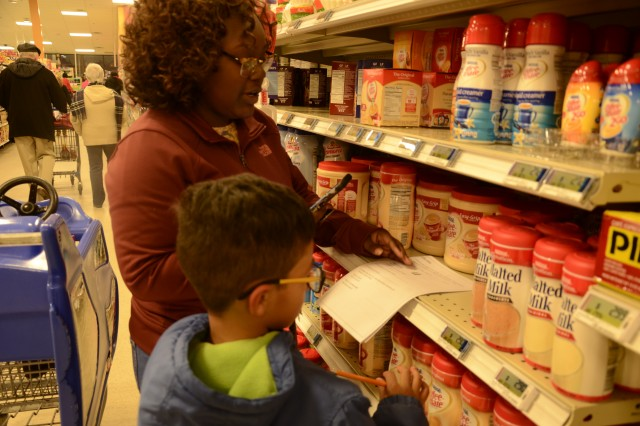 C.C. Pinckney parents and students work together as a team, utilizing math skills to navigate through the store Jan. 18 as part of the annual Math Night at the Commissary. Students used their math skills to check prices, compare values, and weigh and measure items.