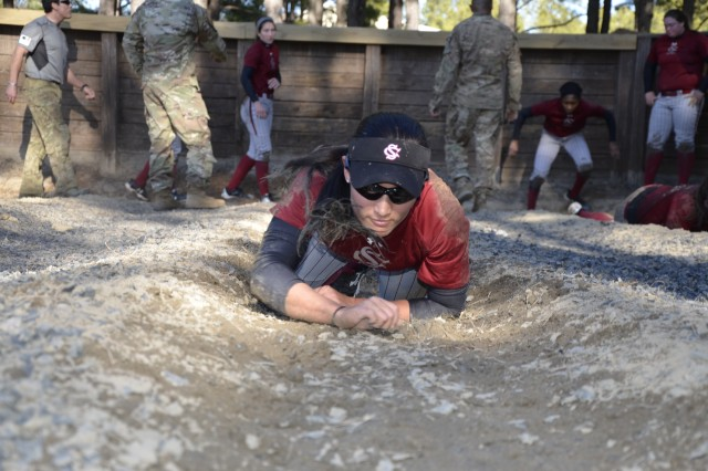Student-athletes from the University of South Carolina softball team maneuver their way through the Fit to Win course Jan. 19 at Fort Jackson. The team used Fort Jackson facilities to build upon their knowledge of and strengthen their team work. The training was given in the same way trainees receive it - with drill sergeants and required complete team participation.