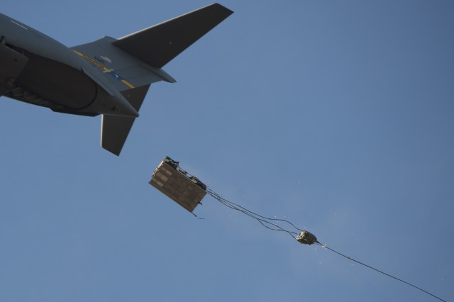 The M-1097 modification Low Velocity Airdrop and Sling Load exits from a U.S. Air Force C-17 aircraft above Sicily Drop Zone at Fort Bragg, North Carolina.