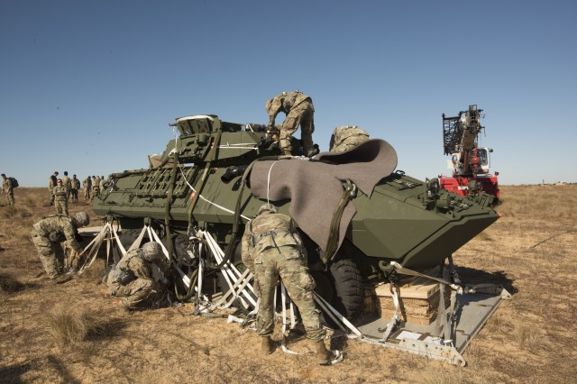 Soldiers from B Company, 5th Squadron 73rd Cavalry Regiment, 3rd Brigade Combat de-rig the LAV-25A2 after air-drop testing at Fort Bragg, North Carolina.