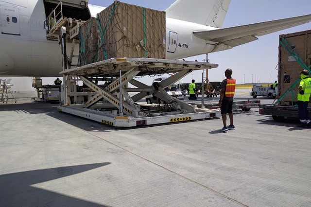 Sgt. Roderic C. Sterling II, a member of the United Arab Emirates Detachment, 831st Transportation Battalion, unloads cargo from a commercial carrier at Al Maktoum International Airport on Apr. 22, 2017.