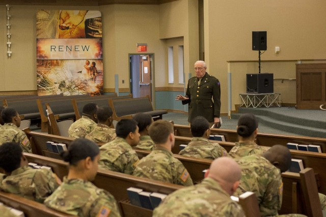 Dr. Dick Stennebaken, retired Army Chaplain (Col.), weaves a tale about being a chaplain during the Nurmeburg trails, to unit ministry teams in attendance at Liberty Chapel, Fort Campbell, Kentucky, 19 Jan. The skit was intended to feel very real, with the majority of attendees not knowing it's just acting. The training was part of a series of visits to installation' UMTs and intended to help them understand their identity in order to provide stronger chaplain services.