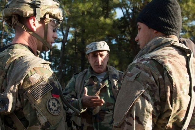 Capt. William Webster, an infantryman assigned to 2nd Battalion, 1st Security Forces Assistance Brigade speaks to a simulated member of the Afghan National Army via a translator during their rotation at the Joint Readiness Training Center, Jan. 23, 2018, at Fort Polk, La. Combat Advisors focus on advising, and enabling foreign partners to increase their readiness and take decisive action. (U.S. Army photo by Spc. Noelle E. Wiehe, 50th Public Affairs Detachment, 3rd Infantry Division Public Affairs)