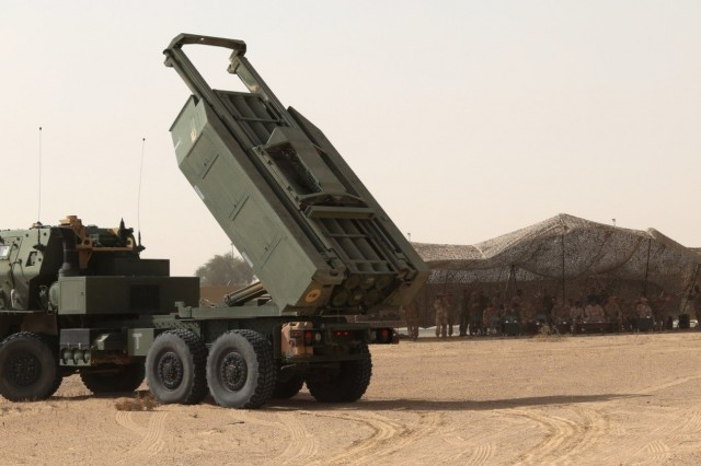 United Arab Emirates- Soldiers of Alpha Battery, 2nd Battalion, 130th Field Artillery, 75th Field Artillery Brigade, 35th Infantry Division, from the Kansas National Guard, work with U.S. Air Force crew to load two M142 High Mobility Artillery Rocket Systems (HIMARS), pre-dawn, in preparation for the Operation Diamond Torrent exercise, at an airbase in the United Arab Emirates, Jan. 21. Operation Diamond Torrent demonstrated the capabilities of the C-17 and the HIMARS as an operational strategic strike package that can rapidly deploy and infiltrate to deliver a fast, flexible and lethal combination wherever needed.