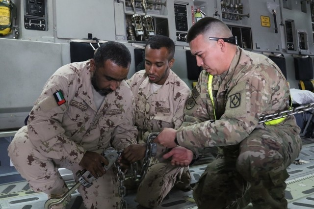 United Arab Emirates- Soldiers of Alpha Battery, 2nd Battalion, 130th Field Artillery, 75th Field Artillery Brigade, 35th Infantry Division, from the Kansas National Guard, work with U.S. Air Force crew to load two M142 High Mobility Artillery Rocket Systems (HIMARS), pre-dawn, in preparation for the Operation Diamond Torrent exercise, at an airbase in the United Arab Emirates, Jan. 21. Operation Diamond Torrent demonstrated the capabilities of the C-17 and the HIMARS as an operational strategic strike package that can rapidly deploy and infiltrate to deliver a fast, flexible and lethal combination where ever needed.