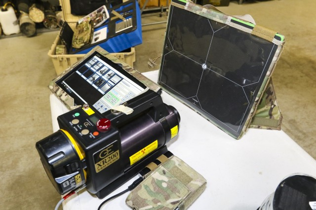The SmartRayVision X1012 portable x-ray systems is presented in a side-by-side comparison with its predecessor, the Science Applications International Corporation (SAIC) RTR-4, Jan. 16, 2018, at the 62nd Ordnance Company Headquarters, Fort Carson, Colo. The comparison offered operators and unit leaders an opportunity to see how the system has advanced over the years and the capabilities gained from the advancements.  (U.S. Army photo by Staff Sgt. Lance Pounds, 71st Ordnance Group (EOD), Public Affairs)