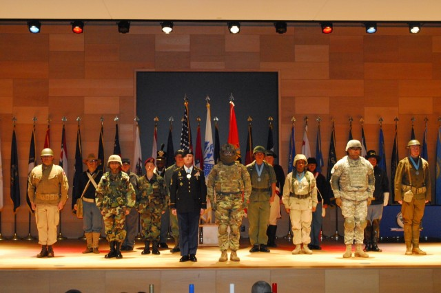 "Aberdeen Proving Ground Soldiers present an historical display of uniforms from every American conflict during the ""I Am the Sergeant"" presentation at the Sergeant Audie Murphy Club Induction Ceremony at Myer Auditorium on Dec. 15."