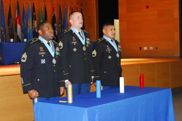 Sgt. 1st Class Gary R. Killiebrew (left) and Staff Sgts. Justin D. Johnson and Hector J. Vega lead NCOs past and present in reciting the 290-word NCO Creed at their induction ceremony to the Sergeant Audie Murphy Club on Dec. 15.