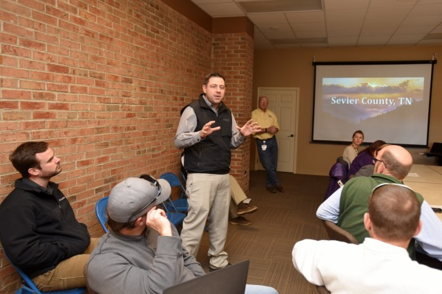 Bryan McCarter, vice mayor of Sevierville, Tenn., welcomes members of Tennessee Silver Jackets to the city's emergency management center Jan. 25, 2018. The Silver Jackets team received a briefing on the wildfires that moved through Sevier County and city of Gatlinburg in November 2016. Silver Jackets is an innovative partnership where local, state and federal agencies facilitate flood risk reduction, coordinates programs, promotes cohesive solutions, synchronizes plans and policies, and ultimately provides integrated solutions. (USACE photo by Leon Roberts)
