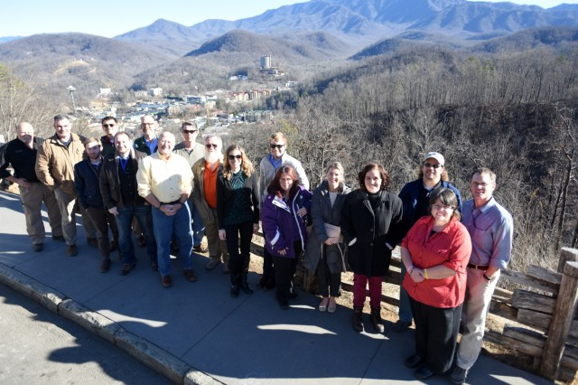 Members of Tennessee Silver Jackets pose at the Gatlinburg Bypass Overlook overlooking Gatlinburg, Tenn., Jan. 25, 2018.  The team toured the area and received a briefing on the wildfires that moved through Sevier County and city of Gatlinburg in November 2016. Silver Jackets is an innovative partnership where local, state and federal agencies facilitate flood risk reduction, coordinates programs, promotes cohesive solutions, synchronizes plans and policies, and ultimately provides integrated solutions. (USACE photo by Leon Roberts)