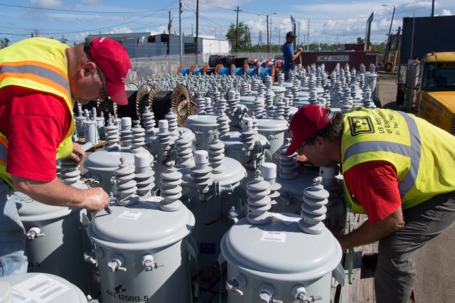 Quality Assurance personnel with the United States Army Corps of Engineers, Taskforce Power Restoration, Andrew Imig and Micheal Nordhaus inspect and inventory KVA - 25 transformers as they arrive in the Palo Seco Warehouse and Laydown yard on January 20, 2018, in San Juan Puerto Rico.  The transformers shipped by air then transported to the Palo Seco warehouse for distribution to the local vendors.  Upon arrival, after inspection and inventory were immediately sent the Puerto Rico Electric Power Authority office in Rio Grande, Puerto Rico. (Photo by Staff Sgt. Eric W. Jones)