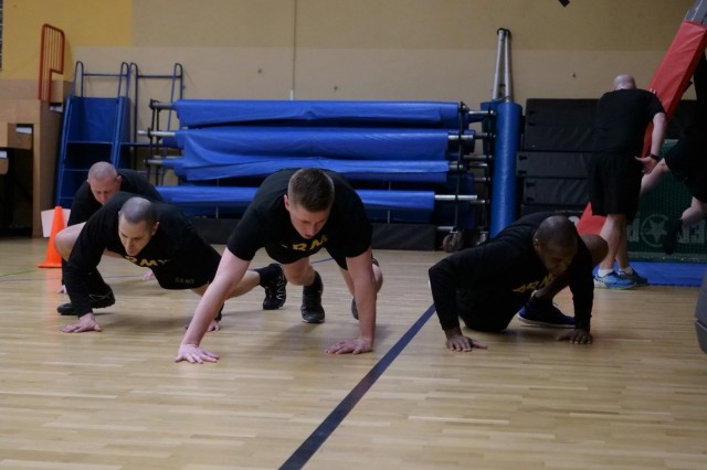 Senior leaders of the 16th Sustainment Brigade conduct spider-man crawls during a high-intensity interval training session at the Hall of Champions, Jan. 23. The intense physical readiness training took place as part of Knights Week, an annual event for company, battalion, and brigade leaders to come together to conduct leader development and team building activities.