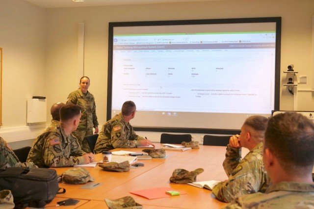 Master Sgt. Ana Springstube, 16th Sustainment Brigade operations non-commissioned-officer-in-charge, conducts a class on the Digital Training Management System to first sergeants and company commanders of the brigade in the Support Operations Center conference room, Jan. 23. The class took place as part of Knights Week, an annual event for company, battalion, and brigade leaders to come together to conduct leader development and team building activities.
