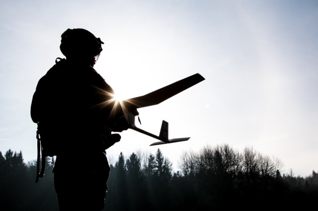 Spc. William Ritter, a military policeman with 287th Military Police Company, 97th Military Police Battalion, 89th Military Police Brigade, Fort Riley, Kansas, prepares to launch a RQ-11B Raven, a Small Unmanned Aircraft System (sUAS), during the Allied Spirit VIII training exercise at Hohenfels Training Area, Germany Jan. 26, 2018. Roughly 4,100 troops from 10 nations are participating in Allied Spirit VIII, a multinational training exercise designed to test participants' readiness and capabilities.